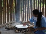 The Shaman's grand daughter making local bread (Cassava)