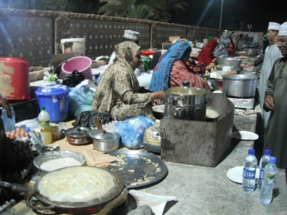 Omani women preparing authentic local delights